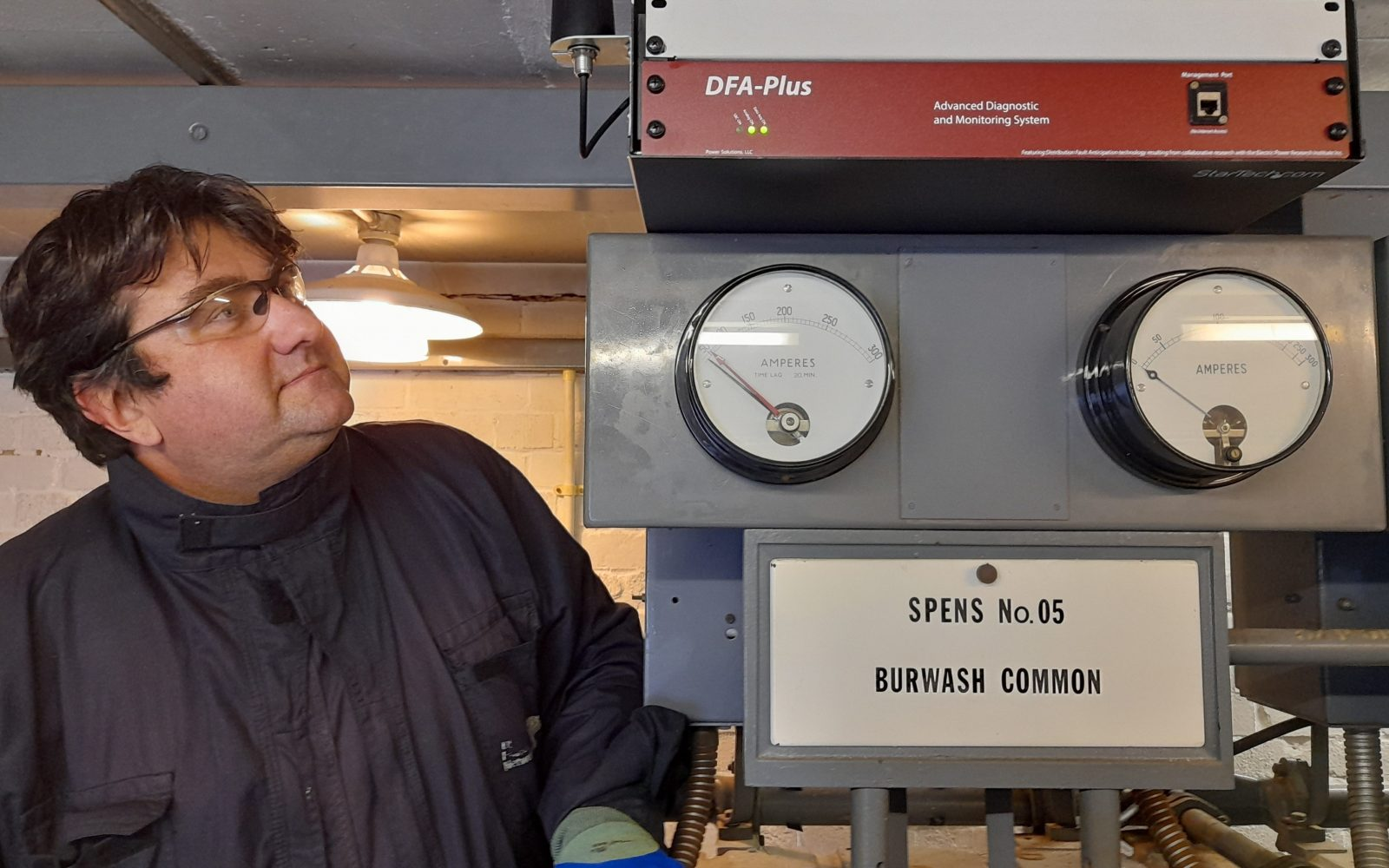 UK Power Networks' senior protection engineer, John Holmes, with a DFA-plus device commissioned at a substation. Image: UKPN.
