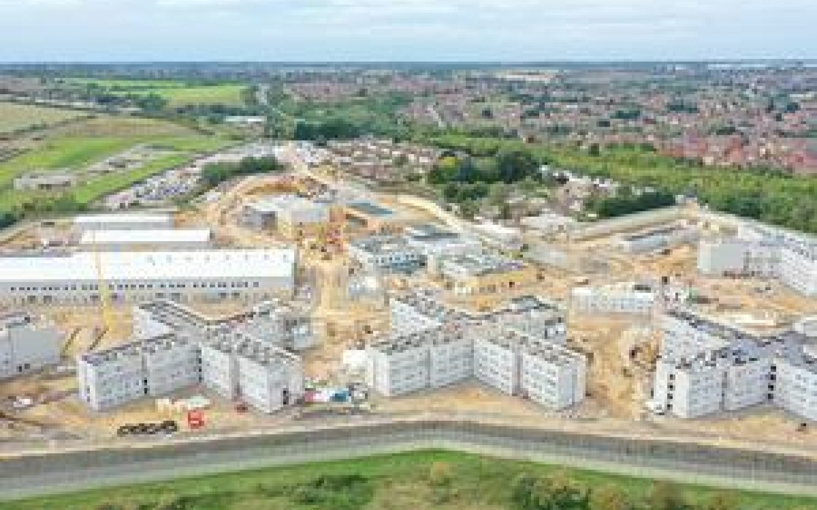 Like other prisons under construction such as HMP Five Wells in Wellingborough (pictured), the new prisons will use recycled materials to reduce carbon. Image: gov.uk.