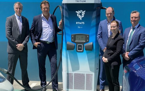 Tritium's executive team (LtoR: David Finn, founder & CGO; David Toomey, CRO; James Kennedy, founder & CTO; Jane Hunter, CEO; and Michael Hipwood, CFO) near an RTM75 at their headquarters in Brisbane, Australia. Image: Tritium.